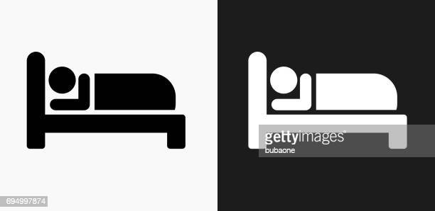 sleeping icon on black and white vector backgrounds - sleeping stock illustrations