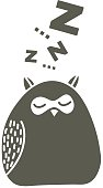 Sleeping owl on the snow.