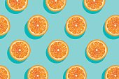 Slices of fresh orange summer background.
