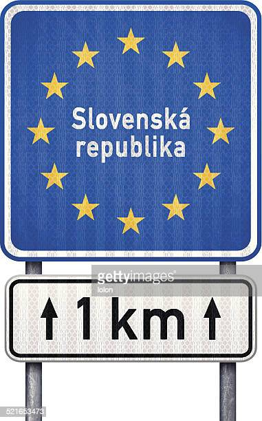 slovakia border traffic sign with white 1 km ahead sign - letrac stock illustrations