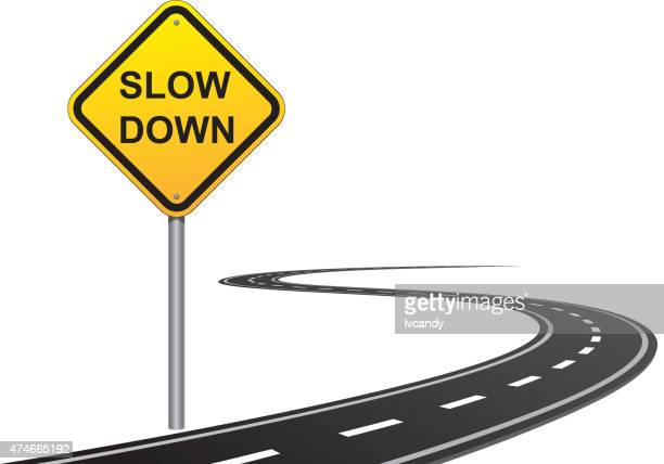 slow down road sign - slow motion stock illustrations