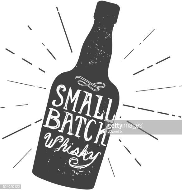 small batch whisky bottle and label hand lettering design - whiskey stock illustrations
