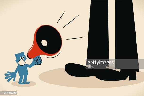 small man talking through megaphone and standing in front of big feet - assertiveness stock illustrations, clip art, cartoons, & icons