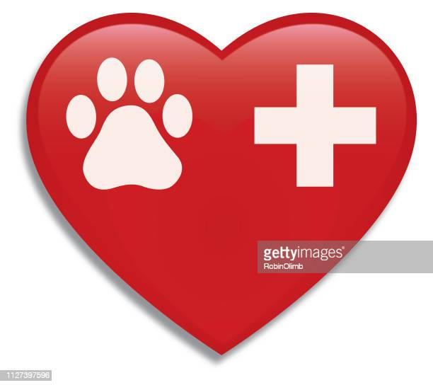 Small Paw Print And Cross On A Red Heart