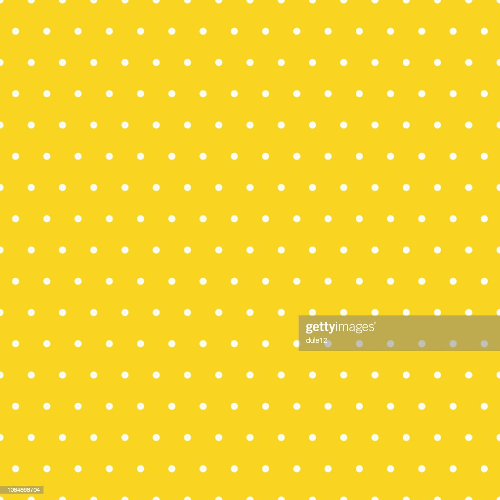 Small Polka Dots Pattern On A Yellow Background