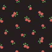 Small tiny red flowers scattered on dark background. Ditsy, liberty floral seamless pattern in traditional folklore style, backdrop and textile design