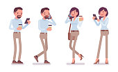 Smart casual man and woman standing with smartphone
