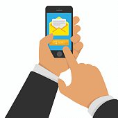 Smart phone in hand with email