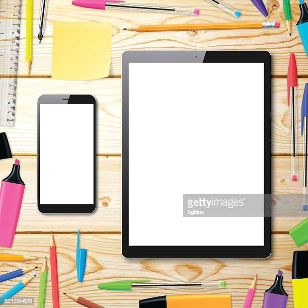 smartphone and tablet pc on wooden desk with office supplies - ballpoint pen stock illustrations, clip art, cartoons, & icons