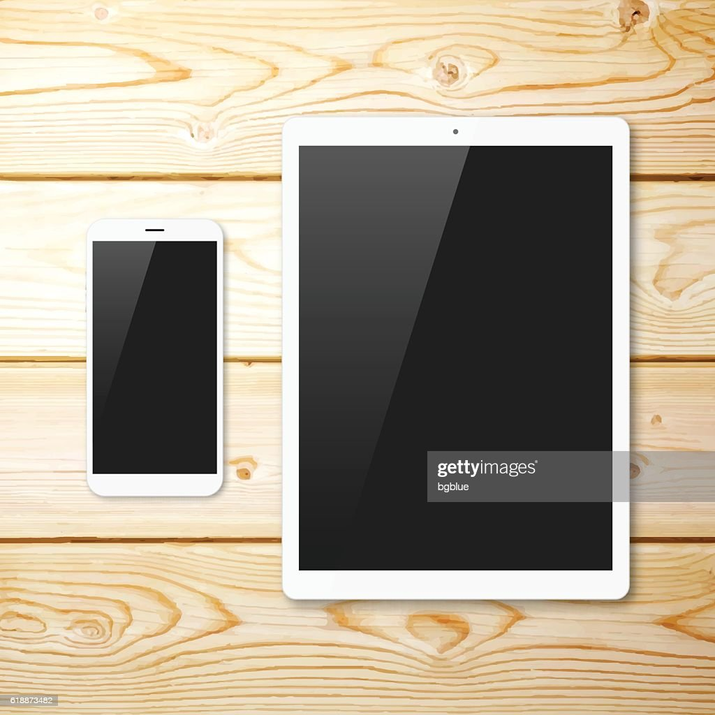 Smartphone and Tablet Pc with blank Screen on Wooden Background