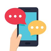 Smartphone black, chatting sms app template bubbles. Human hand holding mobile phone with notification on screen.