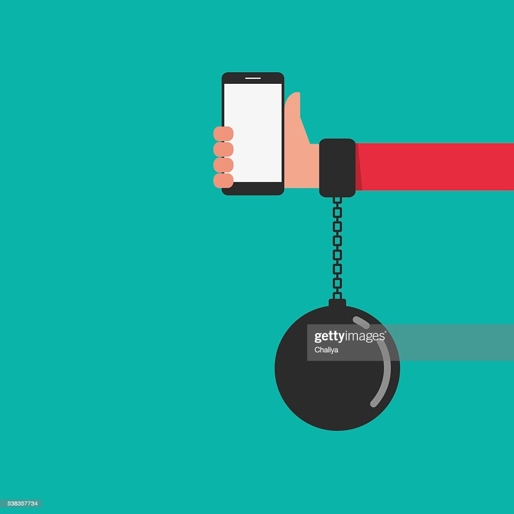 Smartphone chained to handcuff in hand. Smartphone Addiction concept.