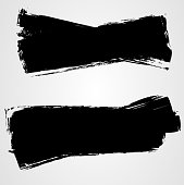 Smears of black paint on white background