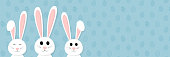 Smiley bunnies on background with eggs and copyspace. Easter concept. Vector.