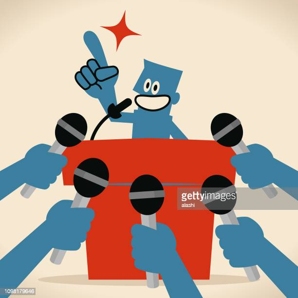 smiling blue man on stage with microphone, press conference. hands holding microphones - press conference stock illustrations, clip art, cartoons, & icons