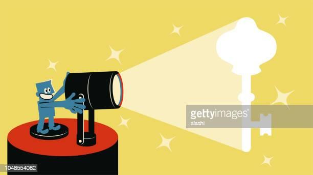 Smiling blue man with spotlight and spotlit Key