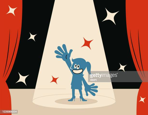 smiling blue woman (host) on stage with spotlight - actor stock illustrations