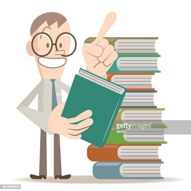 Smiling business man with glasses is taking a book, standing by a stack of books, talking and pointing at upward by index finger