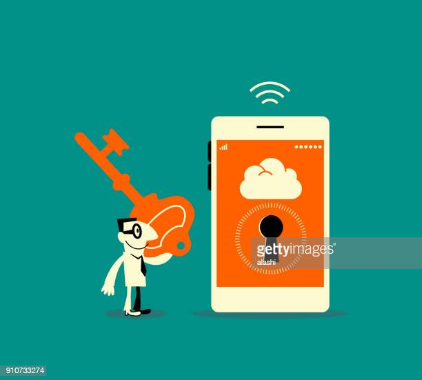 Smiling businessman carrying a big privacy key and standing in front of a smart phone (mobile phone) with keyhole
