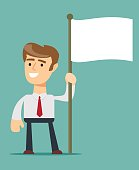 smiling businessman holding flagpole with flag