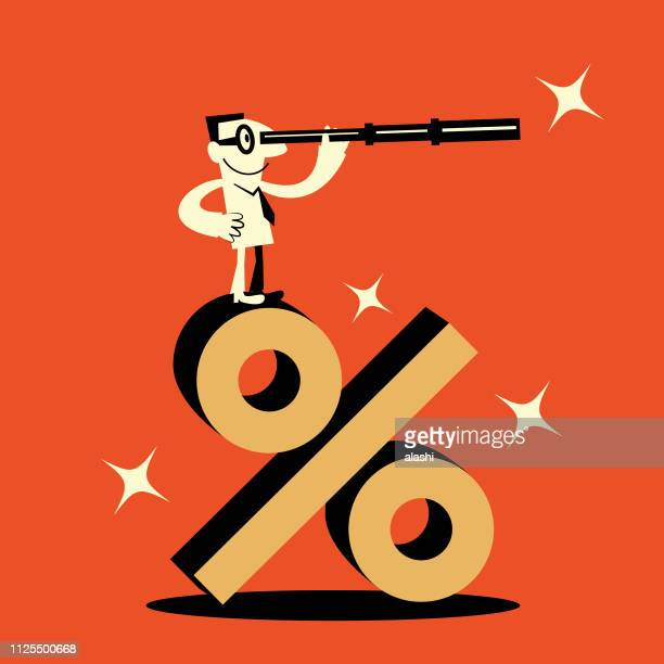 Smiling businessman (Office worker) standing on a big percent symbol and looking through hand-held telescope
