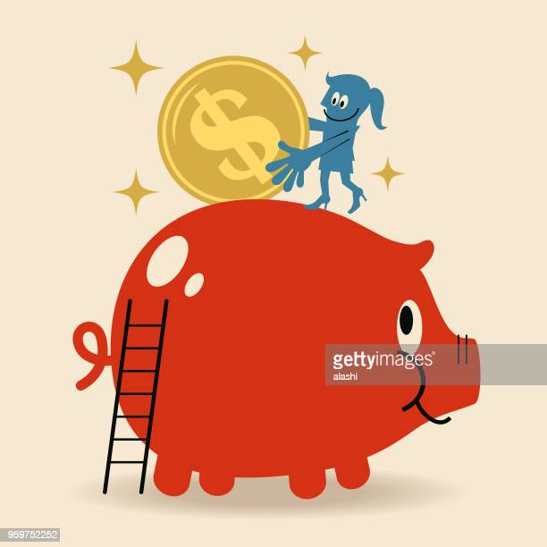 Smiling businesswoman putting a large dollar sign coin currency into a piggy bank