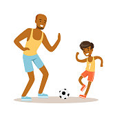 Smiling man and boy playing soccer, dad and son having good time together colorful characters