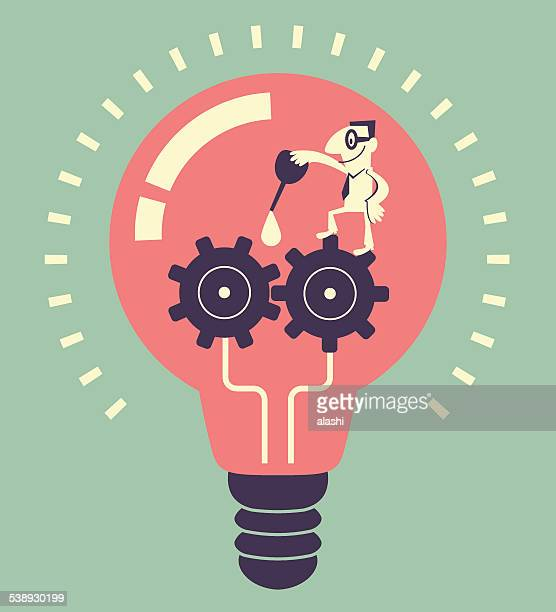 Smiling man lubricating gears with gear oil in idea bulb