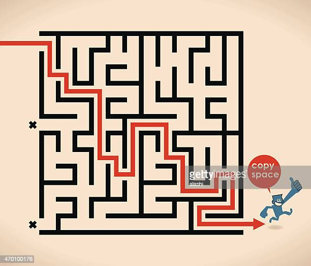 Smiling man (businessman) running out of maze