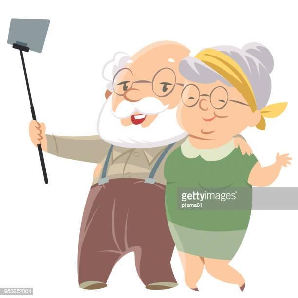 ilustrações de stock, clip art, desenhos animados e ícones de smiling old couple doing selfie - maquina fotografica antiga