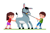 Smiling preschool kids boy pulling stubborn mule and unhappy girl pushing it. Kids cartoon characters playing together with donkey. Flat vector clipart illustration.