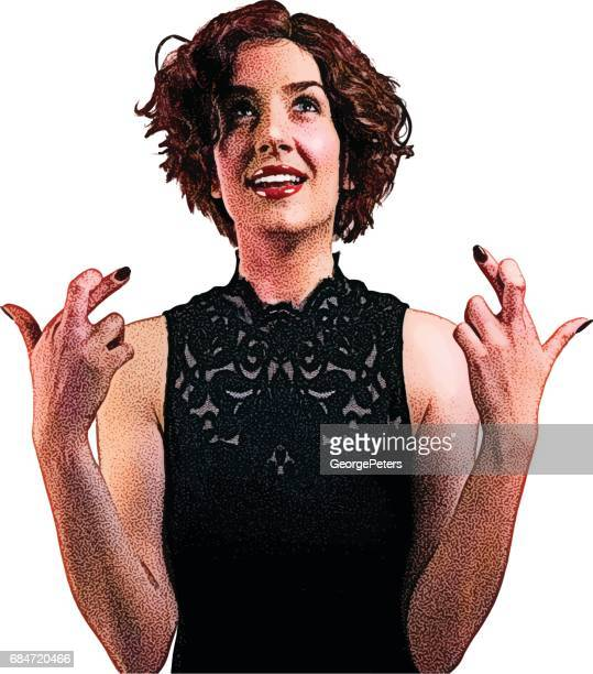 Smiling woman with fingers crossed gesture.