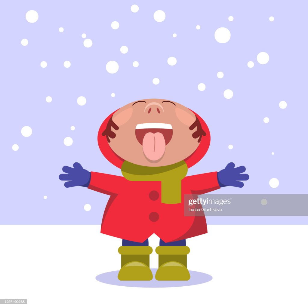 Snow. A child under the snow, catches the language of snowflakes