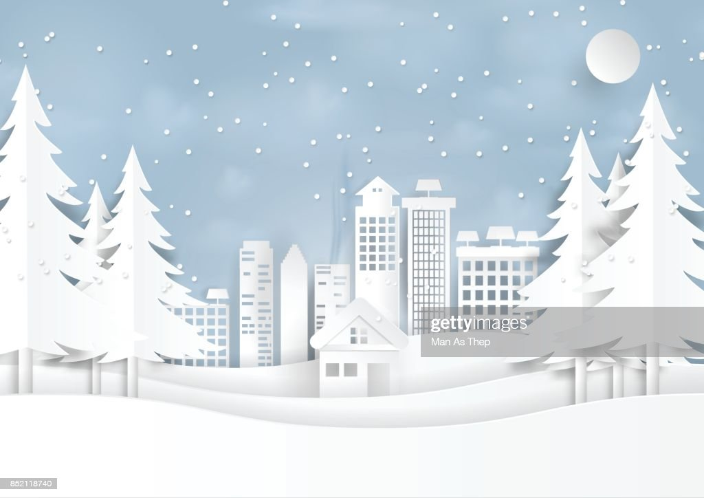 Snow and winter season with urban landscape paper art style