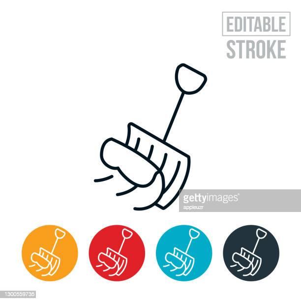 snow shovel pushing snow thin line icon - editable stroke - snow shovel stock illustrations