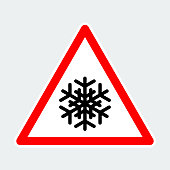 snowflake, warning triangle road sign