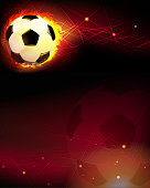 Soccer ball and trail of fire