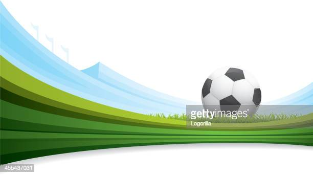 A soccer ball background with green striped grass