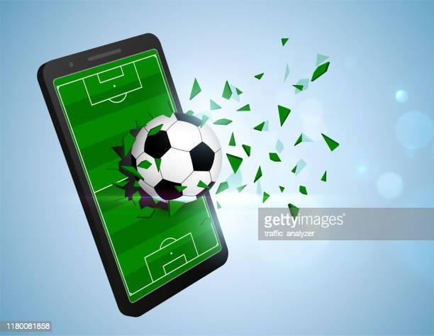 stockillustraties, clipart, cartoons en iconen met soccer ball breaking smartphone - verdediger voetballer