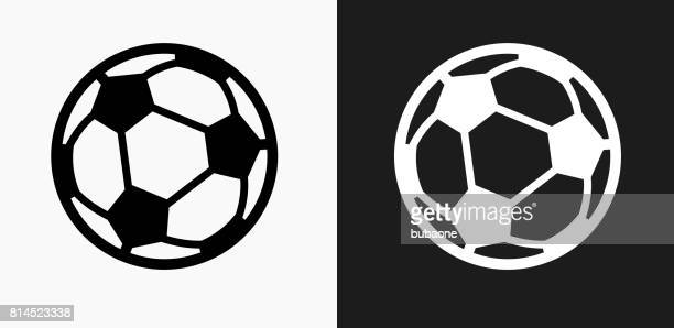 soccer ball icon on black and white vector backgrounds - football stock illustrations