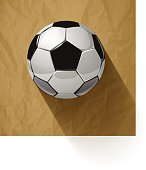 Soccer ball on a crumpled paper brown background. Vector illustration.