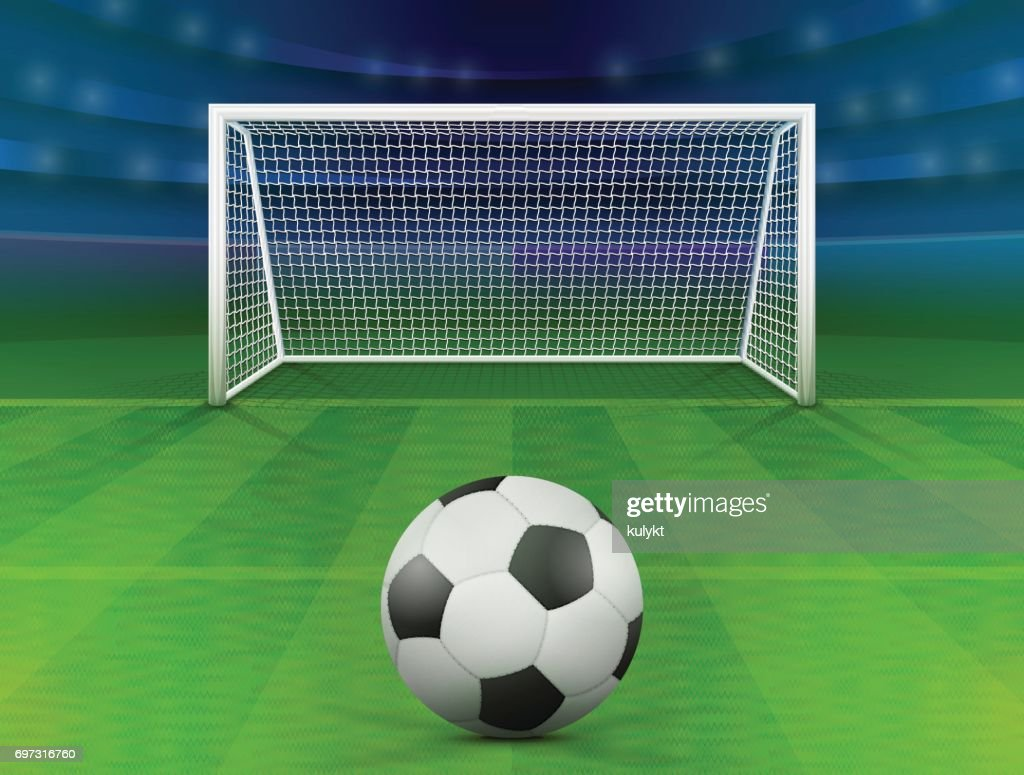 Soccer ball on green field in front of goal post