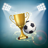 Soccer ball with the golden cup of championship.