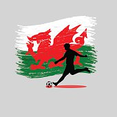 Soccer Player action with Wales flag on background