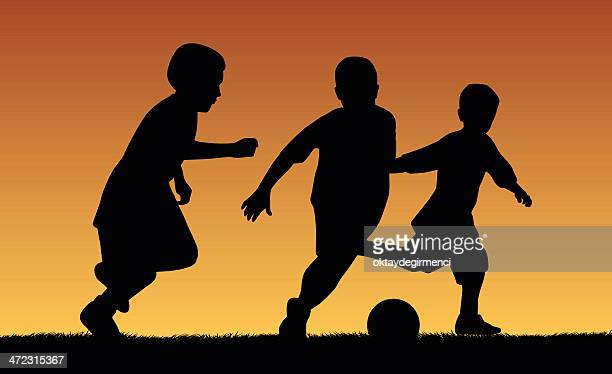 soccer player kids - heading the ball stock illustrations