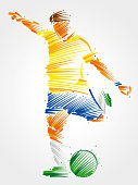 soccer player running to kick the ball
