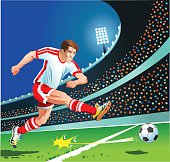 Soccer Player Strikes the Ball
