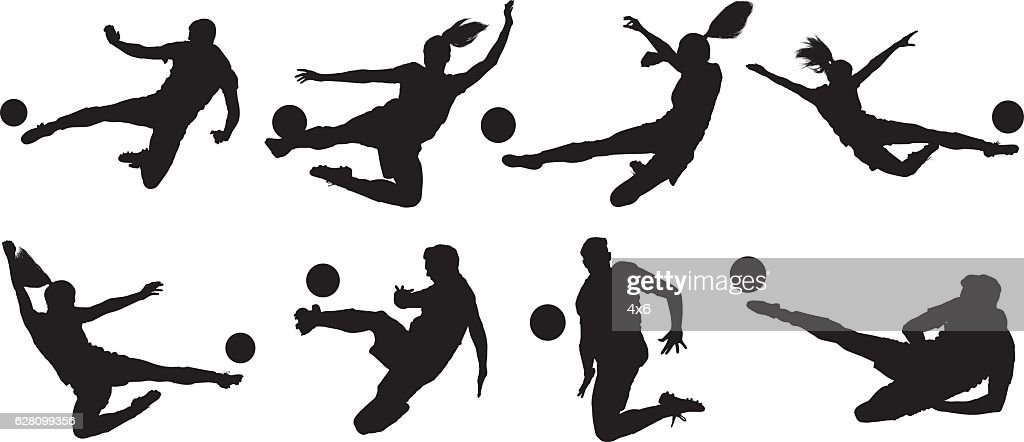 Soccer players kicking the ball