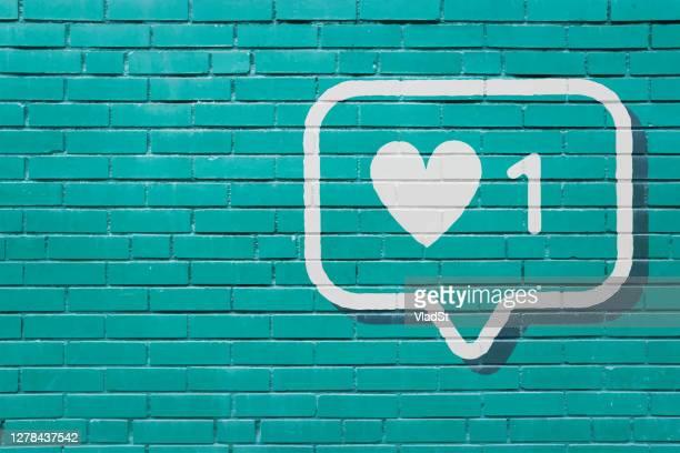 social media notification like brick wall mural background - social media followers stock illustrations