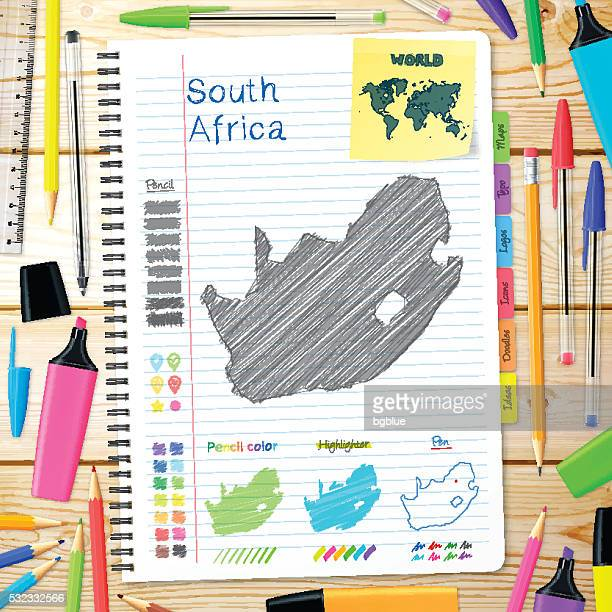 South Africa maps hand drawn on notebook. Wooden Background